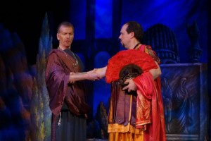 The plotting pagan priest Callistene (Duncan Hartman) greets the Roman general Severo (Robert Garner).